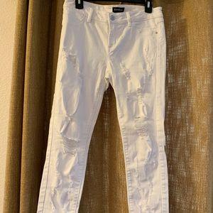 Bebe skinny ripped jeans